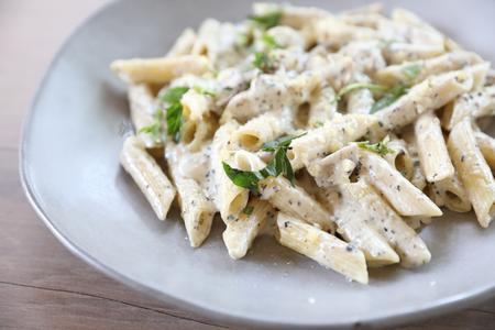 Penne pasta with white sauce and truffle , italian food Archivio Fotografico