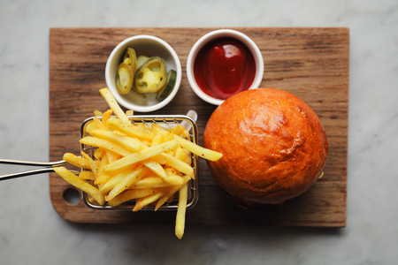 Beef Hamburger with fries and ketchup on wood bard , fast food