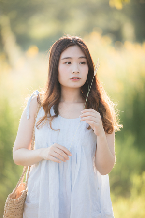 Portrait of Young Asian woman girl smile in flower garden Stock Photo - 124620203