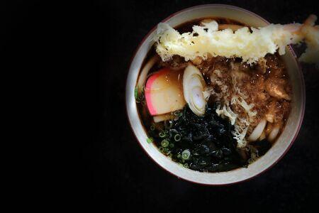 Udon noodles with fried shrimp tempura Japanese food
