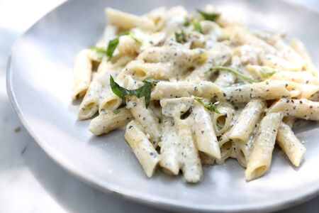 Penne pasta with white sauce and truffle , italian food Stock fotó