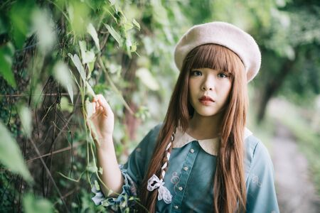 Portrait of asian girl in lolita fashion dress in garden background Reklamní fotografie