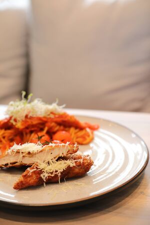 Spaghetti bolognese tomato sauce with fried chicken,