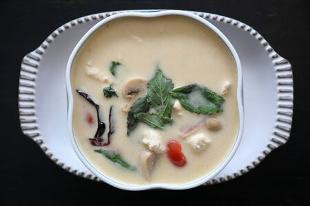 Coconut milk soup with chicken, traditional Thai food