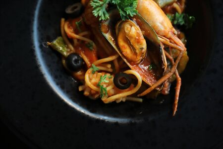 Spaghetti with seafood and tomato sauce