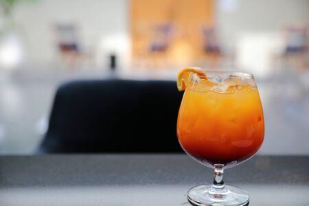Sunrise Cocktail orange pineapple juice in restaurant