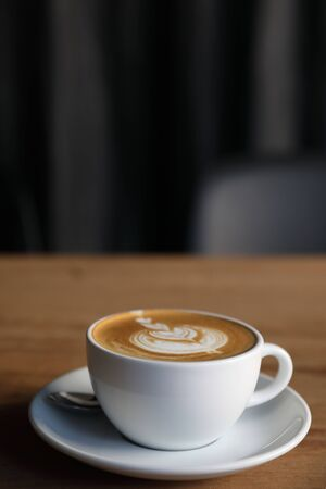 cappuccino or Latte art coffee made from milk on the wood table in coffee shop 版權商用圖片