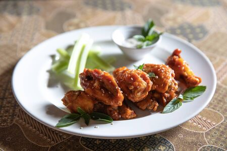 buffalo wings , Fried chicken with hot and spicy sauce