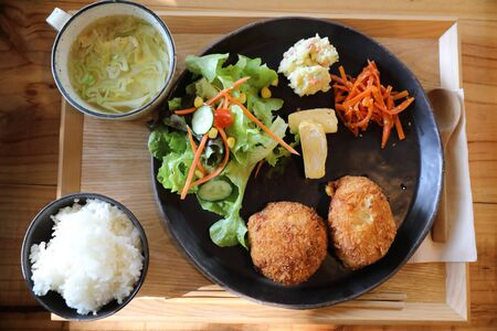 Beef Croquette with rice and salad japanese style Korokke on wooden