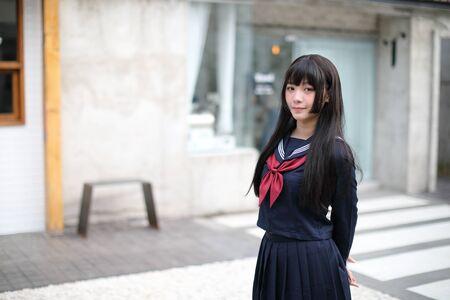 Portrait japanese school girl in downtown ice cream shop