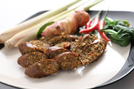 Local Northern Thai food , Northern Thai spicy sausage street food isolated in white background