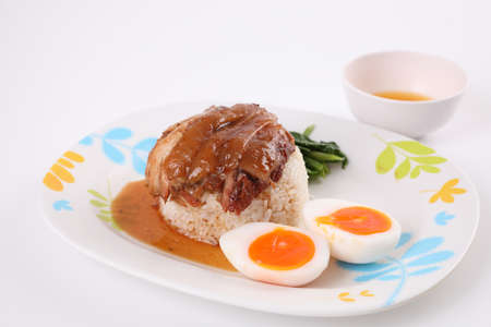 stewed pork leg with rice local Thai food street food isolated in white background
