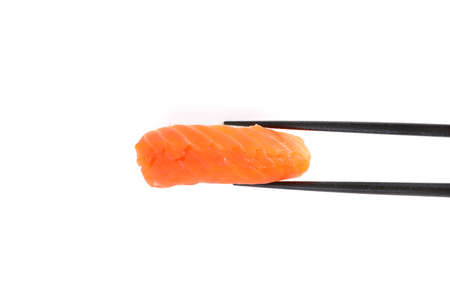 Salmon sushi with chopsticks Japanese food isolated in white background