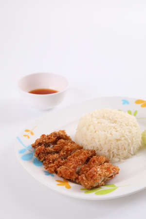 Thai food gourmet fried chicken with rice , khao mun kai in wood background
