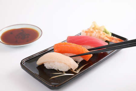 Sushi set , Japanese food sushi salmon tuna shrimp  and sea bass with chopsticks isolated in white background