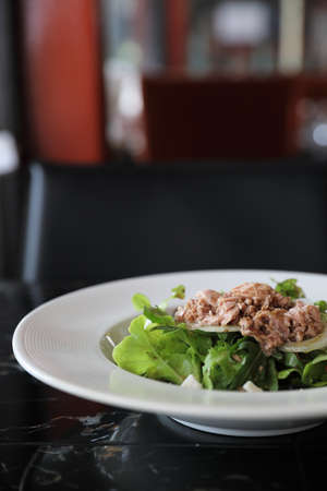 Tuna salad appetizer on wood background