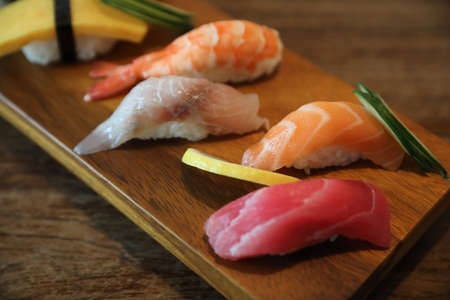 Sushi Set nigiri and sushi maki served on wood Japanese food
