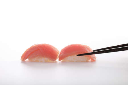 Tuna sushi with chopsticks isolated in white background Stok Fotoğraf