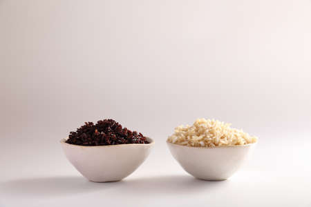 Organic boiled brown rice on bowl isolated in white background