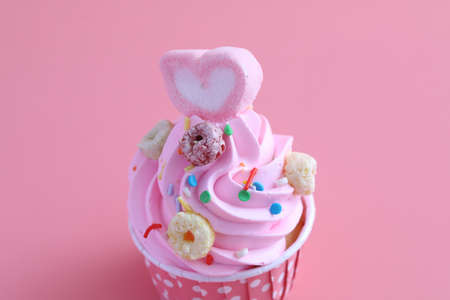 cupcake isolated in pink background