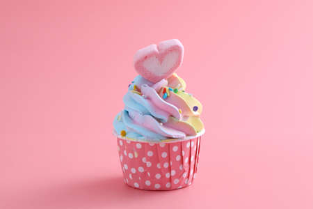 colorful cupcake isolated in pink background Stock Photo