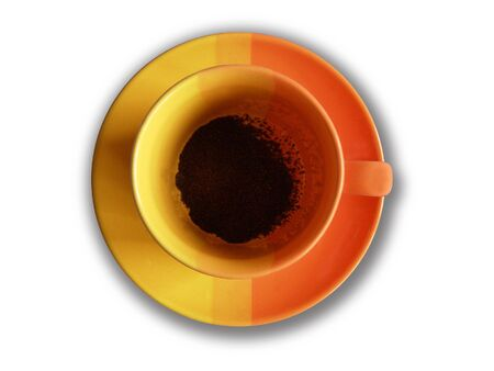 stilllife: Orange yellow pottery cup with coffee powder
