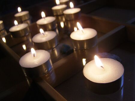 snug: lighted candles on glass table