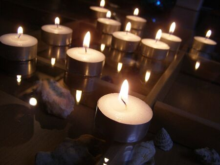 homely: lighted candles on glass table