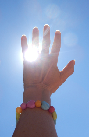 Close-up photography of hand catching the sun. Stok Fotoğraf