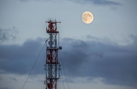 Radio tower and a moon