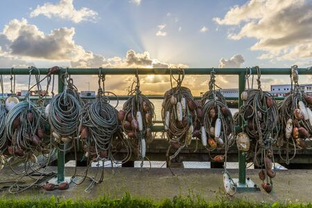 Fishing nets hang on the fence on the island of Helgoland Stock Photo
