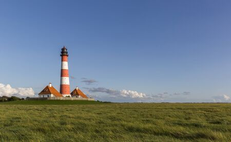 westerhever: Colorful lighthouse at Westerhever, Germany Stock Photo