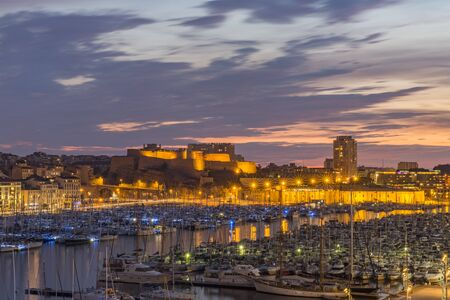 saint nicolas: MARSEILLE, FRANCE - OCTOBER 02, 2017: Evening view of the old port of Marseille and Fort Saint-Nicolas Editorial