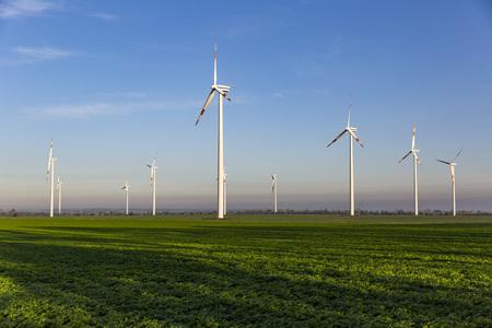 Wind turbines on the green field