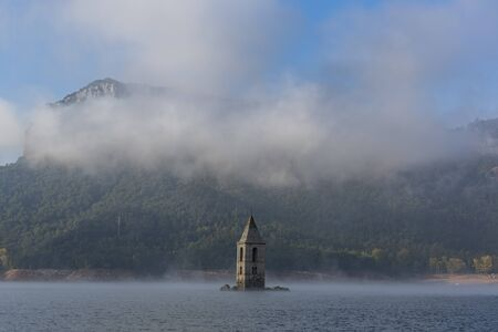 The Church of Sant Roma is a submerged church located on the Sau reservoir, Catalonia, Spain Stock Photo