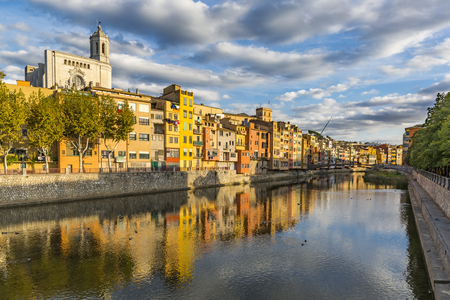 Colorful houses on the banks of the Onyar river in Girona