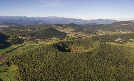 Aerial view of Garrotxa Volcanic Zone Natural Park and Santa Margarida Volcano in the foreground