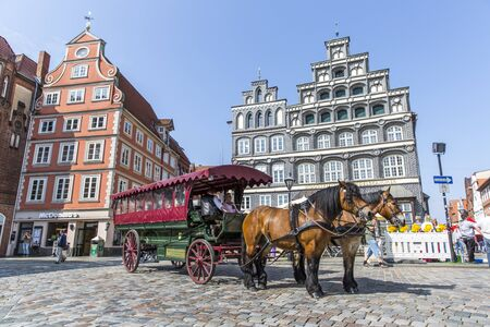 Horse-carriage on the historic square in Luneburg Editorial