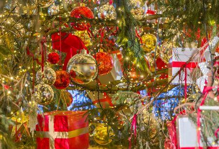Christmas decorations on Christmas tree, balls, boxes
