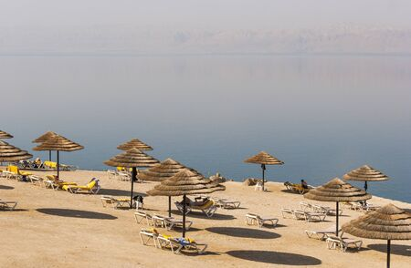 Beach on the Dead sea, one of the worlds saltiest lake Stock Photo