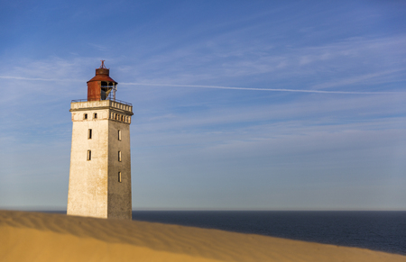 Rubjerg Knude lighthouse buried in sands on the coast of the North Sea 스톡 콘텐츠