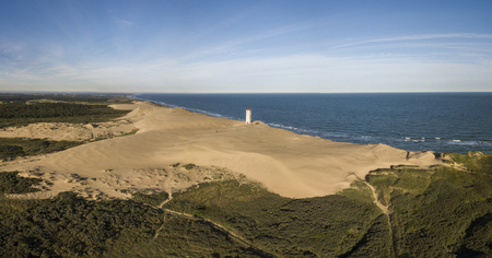 Aerial view of Rubjerg Knude lighthouse buried in sands on the coast of the North Sea Stock Photo