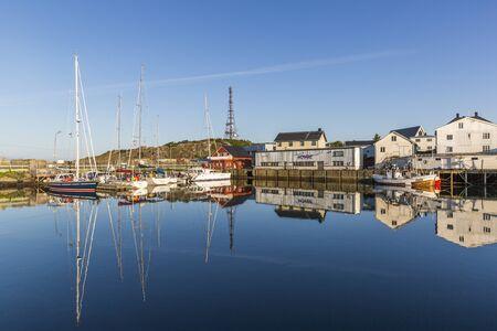 Beautiful reflection in the marina of Henningsvaer fishing village Editorial