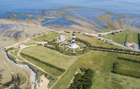 Aerial view of Chassiron lighthouse at low tide Stock Photo
