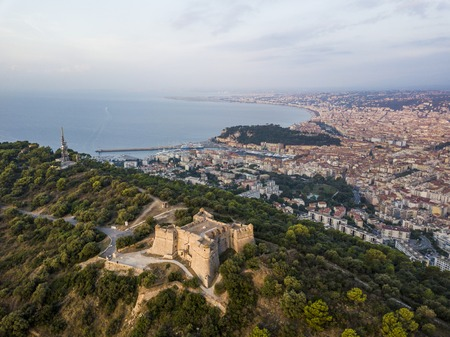 Aerial view of Fort du Mont Alban and the city of Nice at sunrise