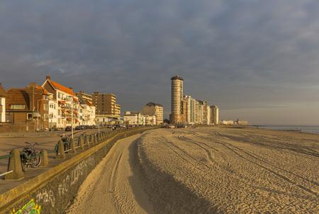 Vlissingen promenade, beach and coastline skyscrapers on sunset