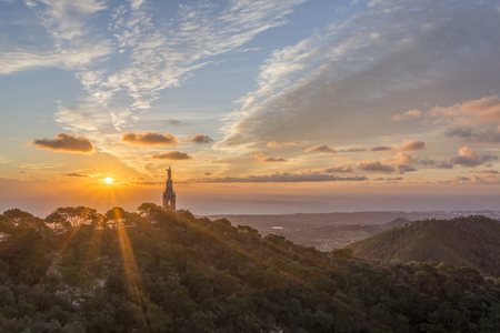 Sunrise over the statue of Christ at the Sant Salvador sanctuary and monastery, Mallorca