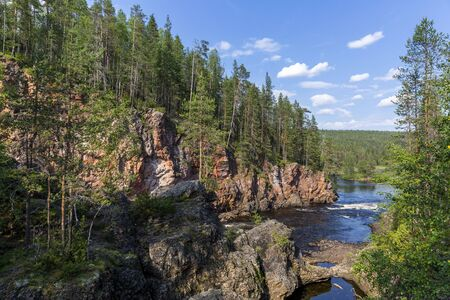 Red cliffs, pine forest and river in Oulanka national park, northern Finland