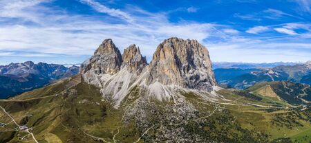 Aerial panorama of Langkofel Group, Grohmannspitze mountain, Fuenffingerspitze mountain and Langkofel Mountain in Italy