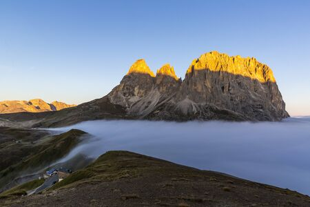 Cloud sea at Sella mountain pass between the provinces of Trentino and South Tyrol, Dolomites Banco de Imagens